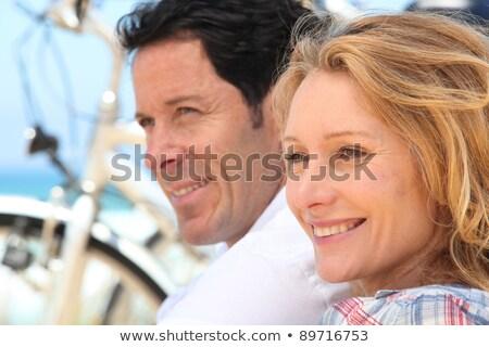 headshot of couple with bikes stock photo © photography33