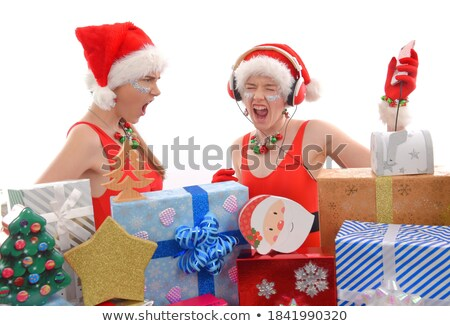 Cheerful girl enjoying music madly Stock photo © stockyimages