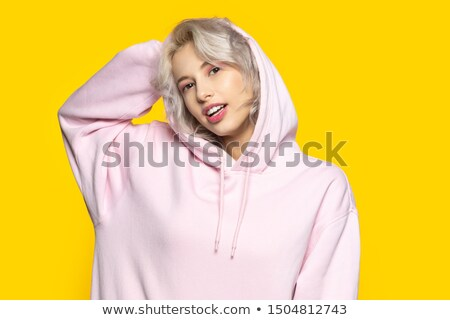 delicate blonde woman wearing yellow sweater stock photo © konradbak