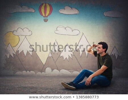 casual man with balloons looks far away Stock photo © feedough