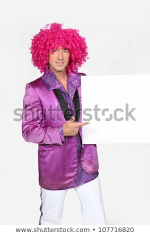 Man dressed in 70s outfit holding blank message board Stock photo © photography33