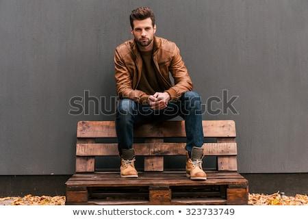 Fiatal divat férfi bőrdzseki portré néz Stock fotó © feedough