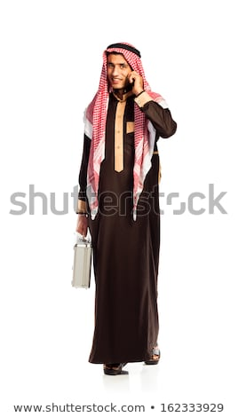 Stock photo: Young smiling arab with a aluminum case isolated on white