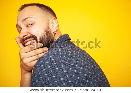 old casual man smiles with hand on chin Stock photo © feedough