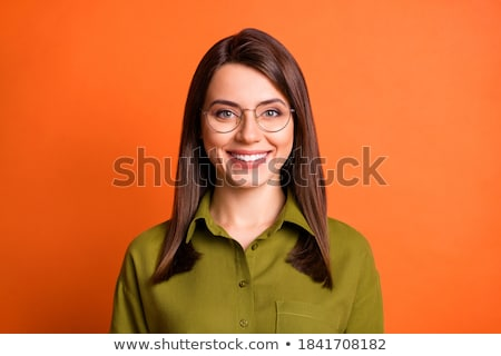 Genç esmer işkadını gözlük gülen parlak Stok fotoğraf © sebastiangauert
