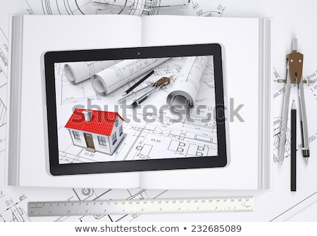 scrolls of architectural drawings and tablet pc stock photo © cherezoff
