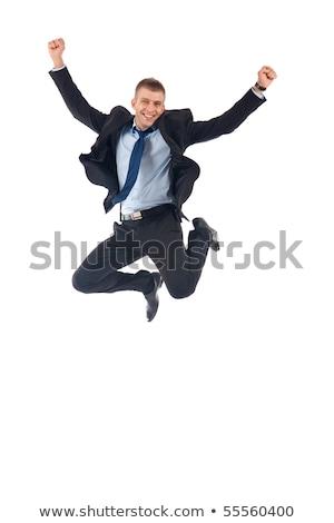 Férfi öltöny nevet ugrik felfelé élvezi Stock fotó © feelphotoart
