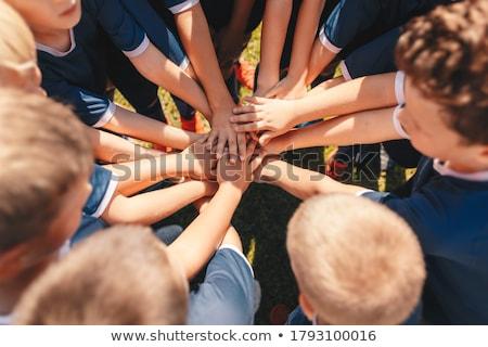 Gemeinschaft · Fußball · Gruppe · Hände · ethnischen · Gruppen - stock foto © alexmillos
