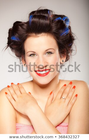 pin up model with nail varnish.  Stock photo © godfer