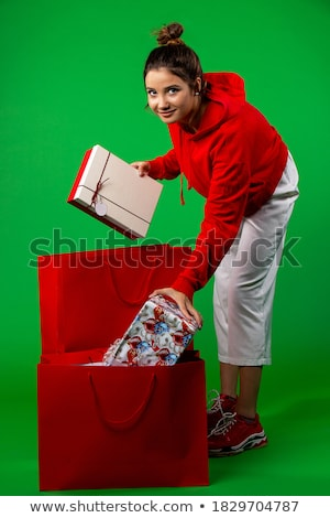 pretty young woman dressed as santa with shopping bags stock photo © nobilior
