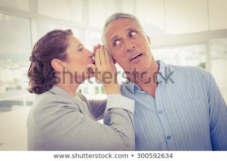 businesswoman whispering into male colleagues ear stock photo © wavebreak_media