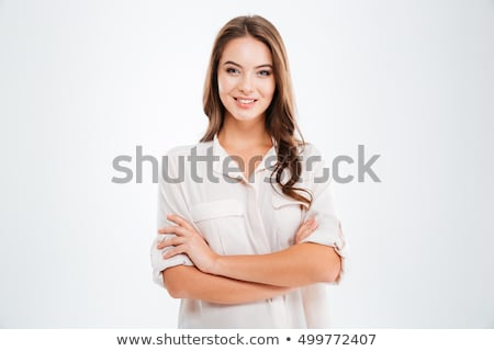 Happy cute woman standing with hands crossed  stock photo © deandrobot