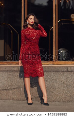 Long hair. Beautiful brunette woman in red lace dress. Beauty gi Stock photo © Victoria_Andreas