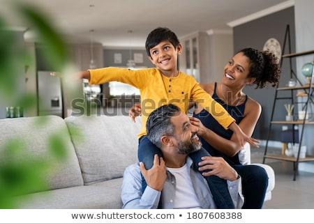 Happy Woman Sitting on Man`s Shoulders  Stock photo © dariazu