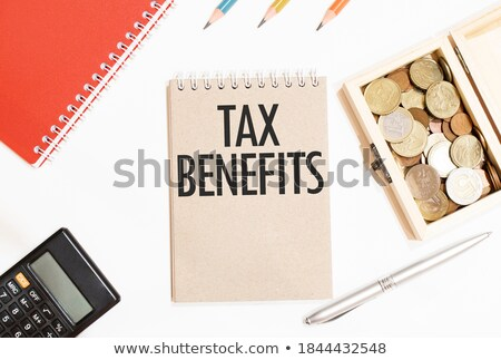 Taxes text on notepad and pencil Stock photo © fuzzbones0