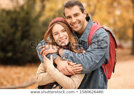 Casual female walking in autumn park with backpack Stock photo © stevanovicigor