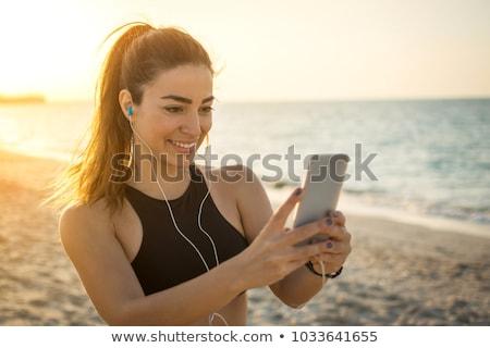 Női kezek sms chat üzenet mobiltelefon vízpart Stock fotó © stevanovicigor