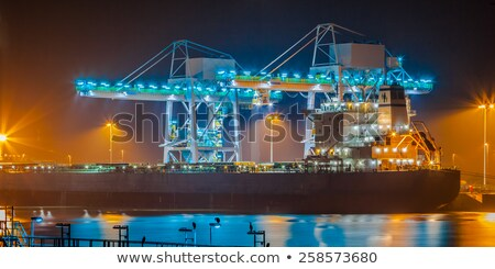 Freight ship under loading in the Port of Rotterdam Stock photo © janssenkruseproducti