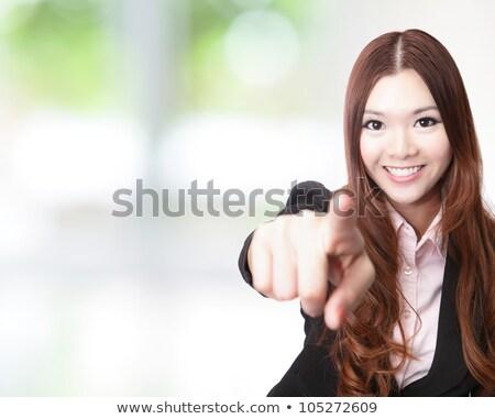 feliz · asiático · mulher · jovem · indicação · dedo · pessoas - foto stock © szefei