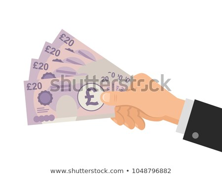 hand holding a pound currency symbol. Stock photo © alexmillos