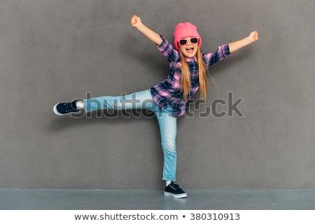 girl posing in motion in studio stock photo © bezikus