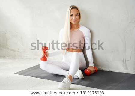 smiling fitness lady holding sports rug stock photo © deandrobot