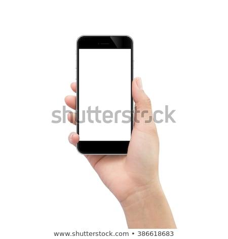 Female hand holding mobile phone with blank mock up screen Stock photo © stevanovicigor