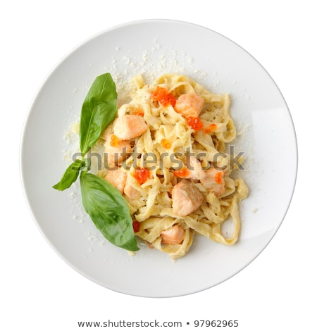 Pasta fettuccine with salmon and caviar on a white dish on a woo stock photo © Yatsenko