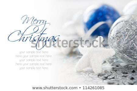 merry christmas card with blue bauble stock photo © fresh_5265954