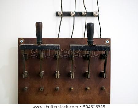Oude elektrische schakelaar industriële lichtschakelaar selectieve aandacht Stockfoto © stevanovicigor