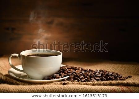 Café preto feijões pano de saco saco mesa de madeira fundo Foto stock © master1305