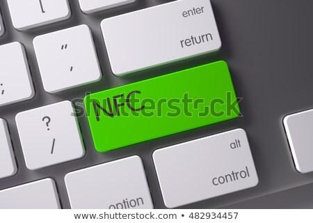 Keyboard with Green Button - NFC. 3D. Stock photo © tashatuvango