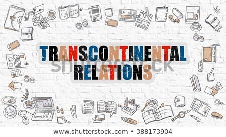 transcontinental relations concept multicolor on white brickwall stock photo © tashatuvango