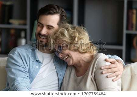 Older man talking to younger woman Stock photo © IS2