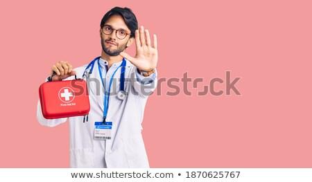 Młodych hiszpańskie lekarza pierwsza pomoc polu Zdjęcia stock © RAStudio