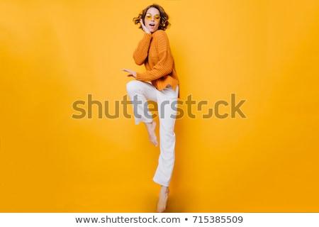 Fiatal nő rövid nadrág kéz arc pózol Stock fotó © feedough