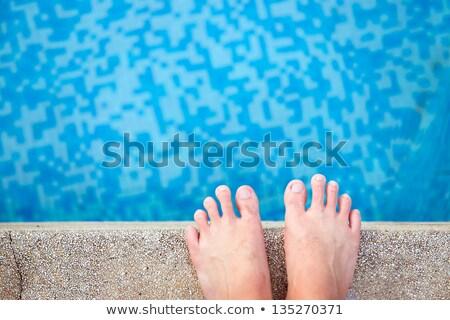 male feet in outdoor swimming pool stock photo © stevanovicigor