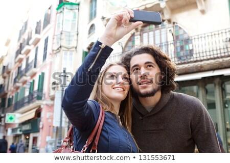 travel discovery   female tourist taking photos of a city stock photo © lightpoet