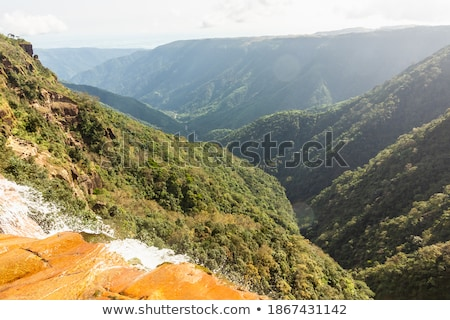 Waterfall on forested hillside Stock photo © IS2