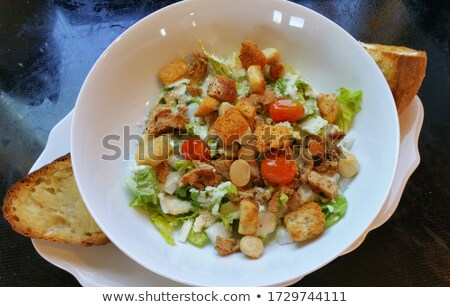 Close up of a salad garlic isolated over white Stock photo © deandrobot