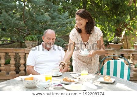 Senior woman serving breakfast in garden Stock photo © wavebreak_media