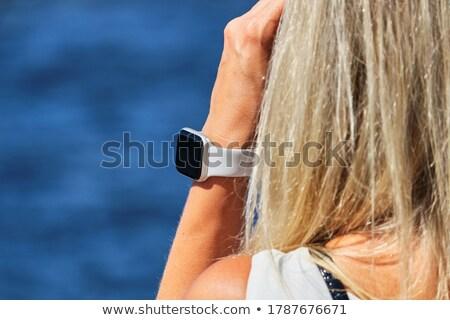 Girl running on city street looking at sea Stock photo © blasbike