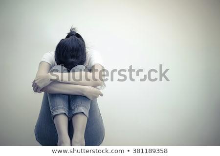 Sad woman sitting on the bad Stock photo © konradbak
