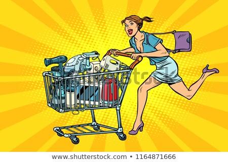 woman on sale of home appliances. shopping cart shop trolley Stock photo © studiostoks