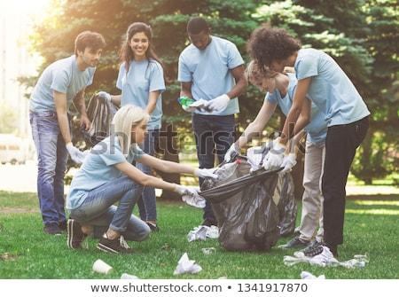 Foto stock: Grupo · voluntarios · basura · bolsas · parque · voluntariado
