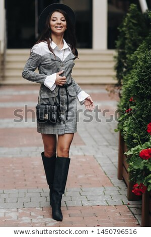 Image of pretty woman 20s wearing casual clothing laughing, stan Stock photo © deandrobot