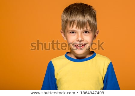 Adorable little boy in front of an empty wall Stock photo © ra2studio