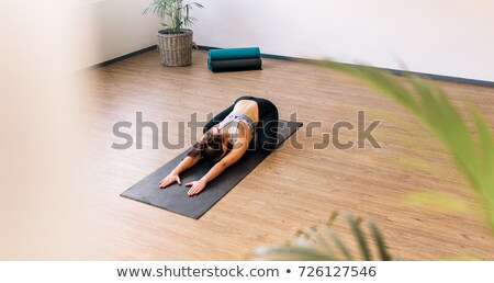 High Angle View Of A Woman Practicing Yoga Stock photo © AndreyPopov