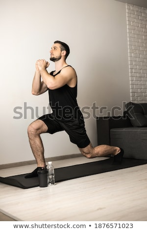 Adult Man Fitness Training At Home Stretching Muscles Before Workout Stock photo © diego_cervo