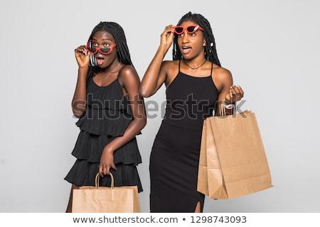 Geschokt jonge zakenvrouw poseren geïsoleerd grijs Stockfoto © deandrobot